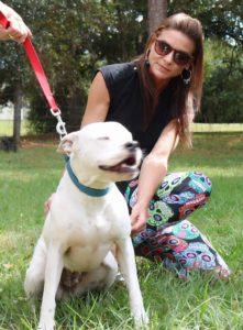 Cassie Ottofaro of The Terrio Group bonds with a special new friend at Nala's New Life Rescue.